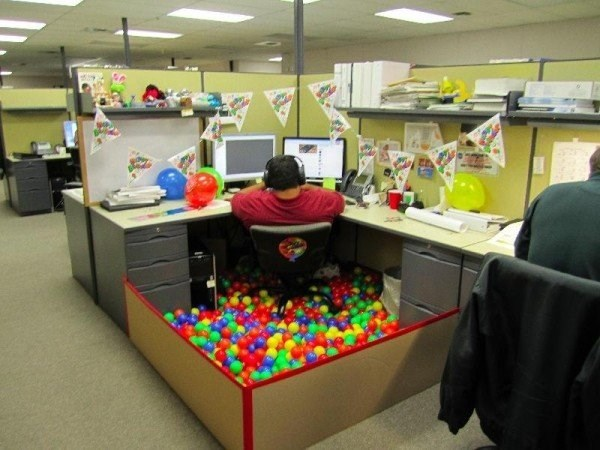 Cubicle that has ball pit built around it.