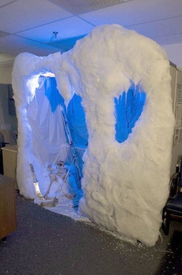 Office prank of workers cubicle taken over by snow