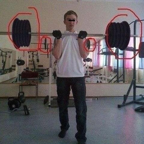Very funny photoshop FAIL of a kid that is lifting way more weight in the pic than in the reflection behind him.