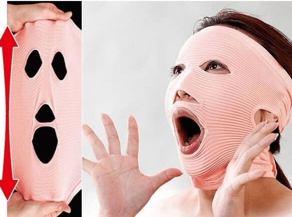 Woman models salmon-colored robber mask and makes scared expression.