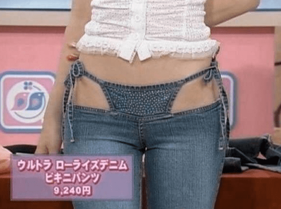 Woman models thong that is built into her pair of jeans.