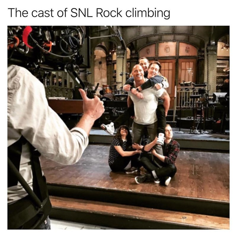 The cast of Saturday Night Live climbing the Rock.
