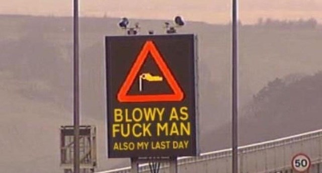 Scottish tweet of a road sign warning people about the wind and that it's the employees last day