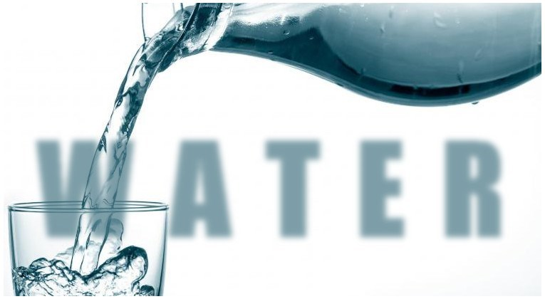 Graphic of water being poured into a glass with the word WATER in impact font dissolved in the background.