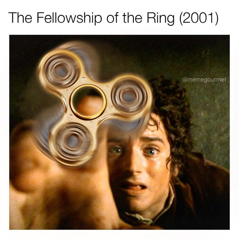 Funny Instagram meme that inserts a fidget spinner into the poster of the Fellowship of the Ring.