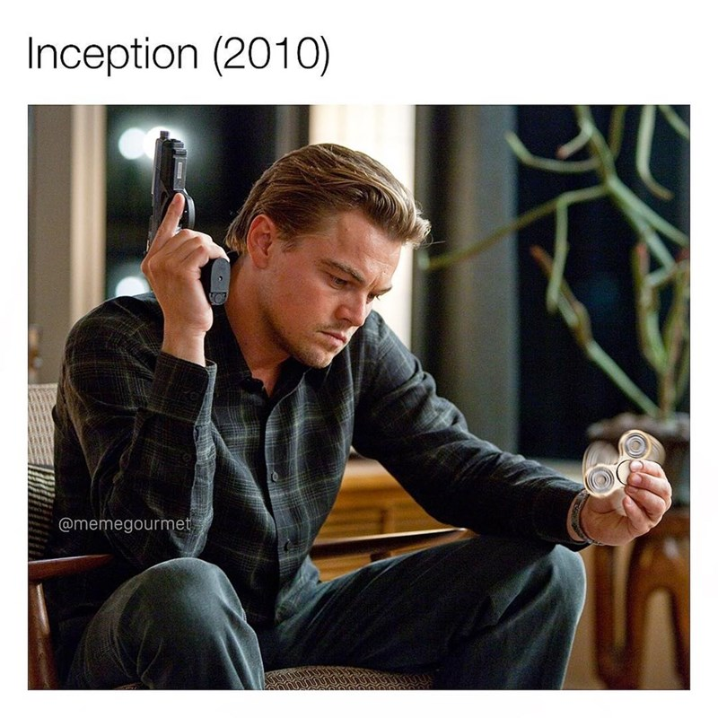 Funny meme inserting a fidget spinner into a still from the 2010 movie Inception starring Leonardo DiCaprio.