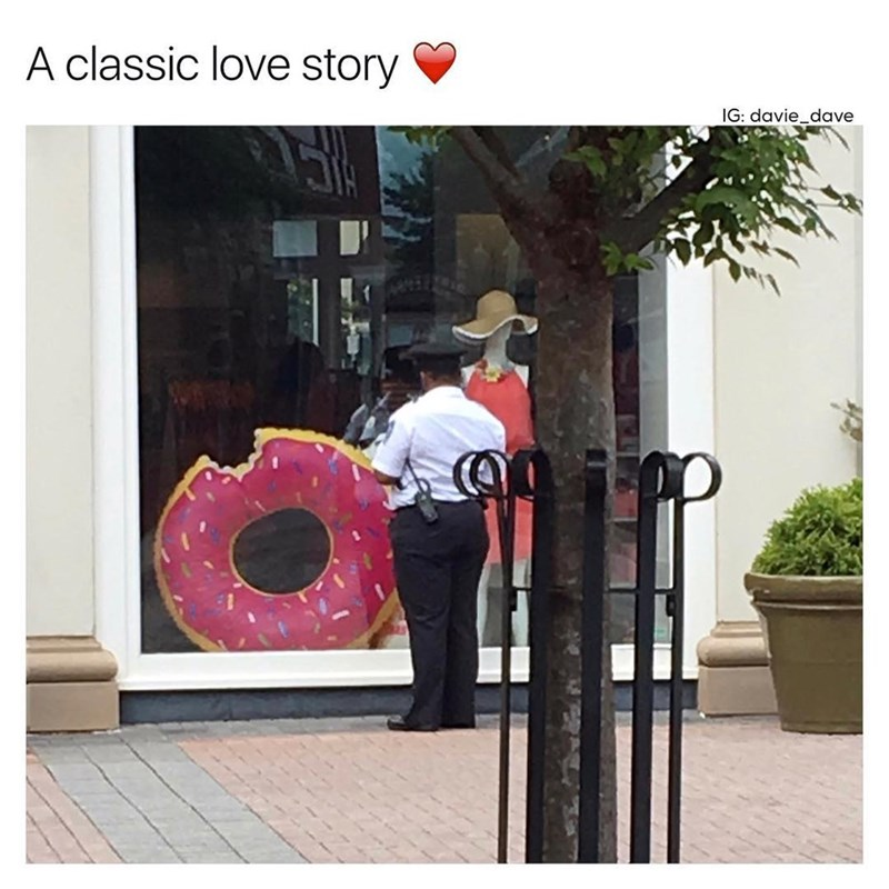 Funny meme about how cops love doughnuts, posing as a love story - image is a cop looking into a window with a giant doughnut.