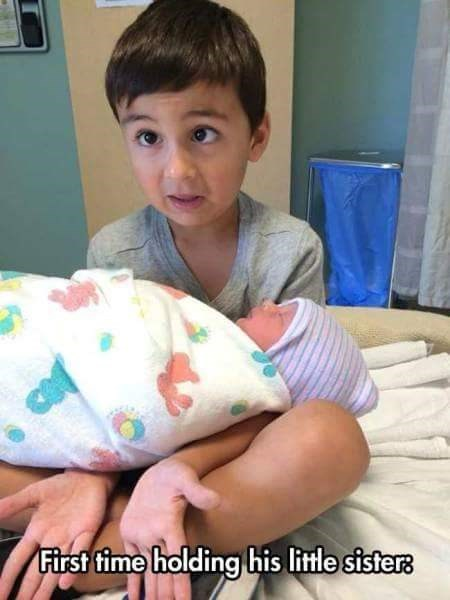 Child - First time holding his little sisters