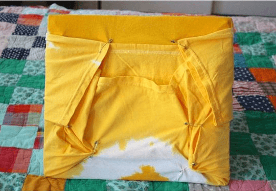 Shirt tightened from the bottom and secured tautly to the tent wire-frames