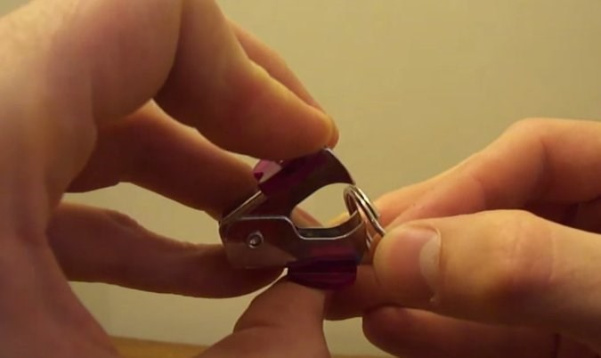 Staple remover to open up a key ring.
