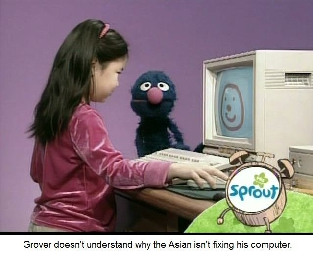bert and ernie - Cartoon - sprout Grover doesn't understand why the Asian isn't fixing his computer