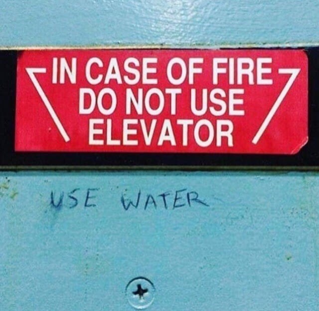 Text - -IN CASE OF FIRE DO NOT USE ELEVATOR uSE WATER
