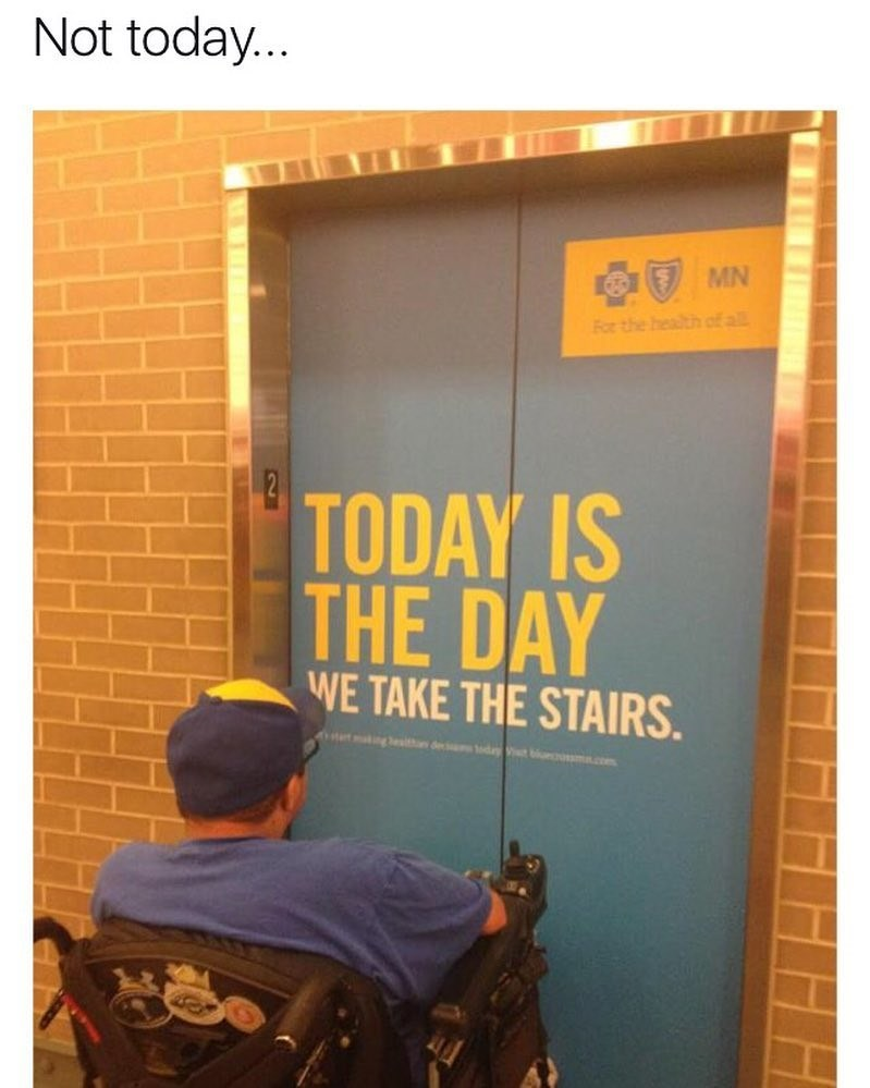 """Funny meme of a man in a wheelchair looking at an ad on an elevator which says """"today is the day we take the stairs."""" Meme text says """"Not today."""""""