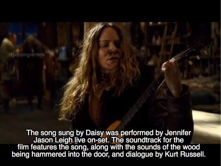 Music - @poppingremlins The song sung by Daisy was performed by Jennifer Jason Leigh.live on-set. The soundtrack for the film features the song, along with the sounds of the wood being hammered into the door, and dialogue by Kurt Russell.