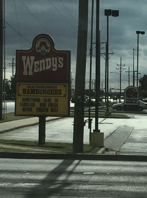 Text - WENDYS OLD FASHIONED HAMBURGERS SOMETHING ELSE IS FAMILIAR OUR FRESH NEVER FROZER BEEF ELL