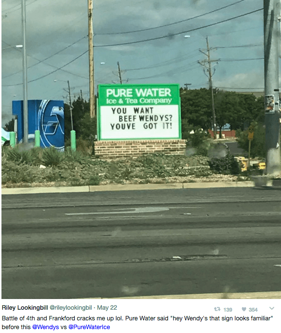 """Road - PURE WATER Ice &Tea Company YOU WANT BEEF WENDYS? YOUVE GOT IT! Riley Lookingbill @rileylookingbil May 22 13 139 354 Battle of 4th and Frankford cracks me up lol. Pure Water said """"hey Wendy's that sign looks familiar"""" before this @Wendys vs @PureWaterlce"""