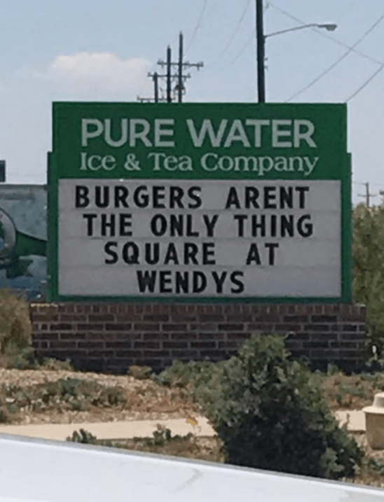 Street sign - PURE WATER Ice &Tea Company BURGERS ARENT THE ONLY THING SQUARE AT WENDYS