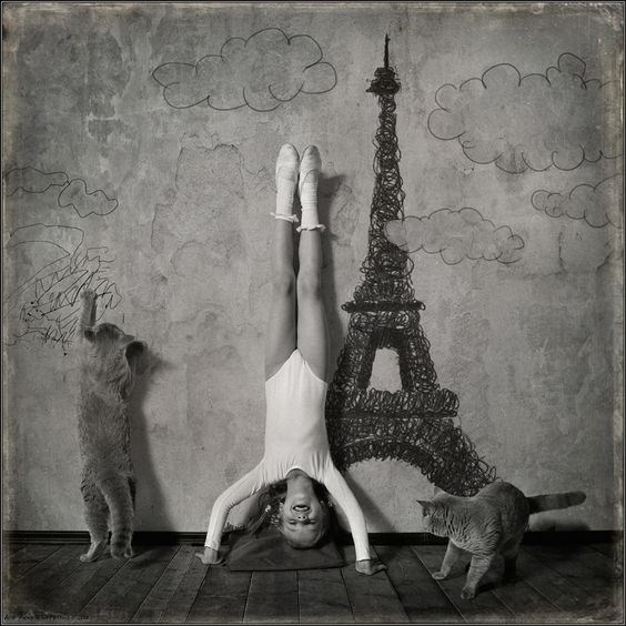 Viva Paris photo by Andy Prokh of cats and girl playing by Eiffel tower artwork.