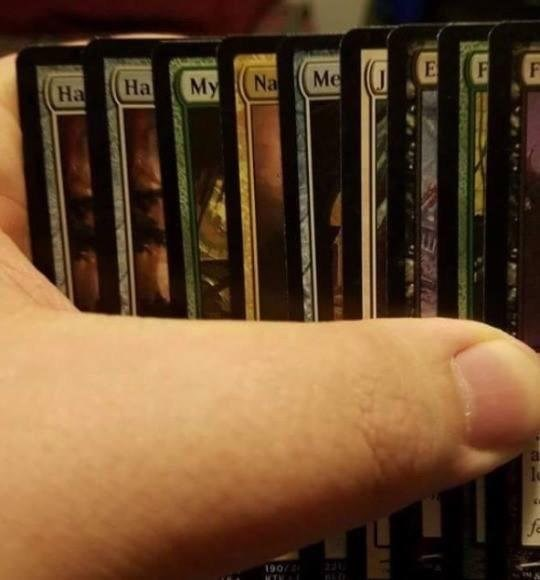 collection of cards that are in protective sleeves.