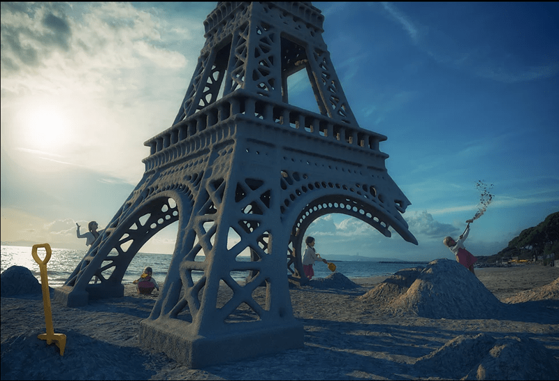 Surreal photo by John Wilhel of his daughters playing in the ruins of an Eiffel Tower