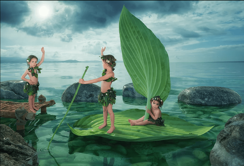 John Wilhel fantasy photograph of kids floating on leafs in a magical land.
