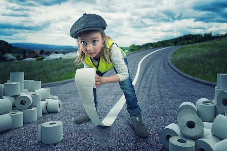 John Wilhel pic of his little girl making stripes on the road with toilet paper
