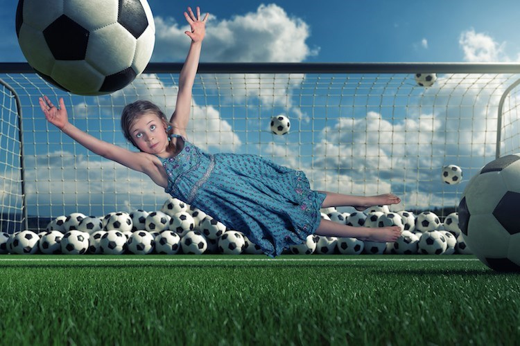 John Wilhel picture of girl blocking a goal.