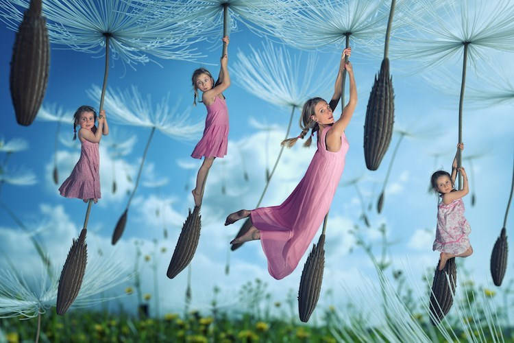 Magical picture by John Wilhel of girls floating away on dandelion