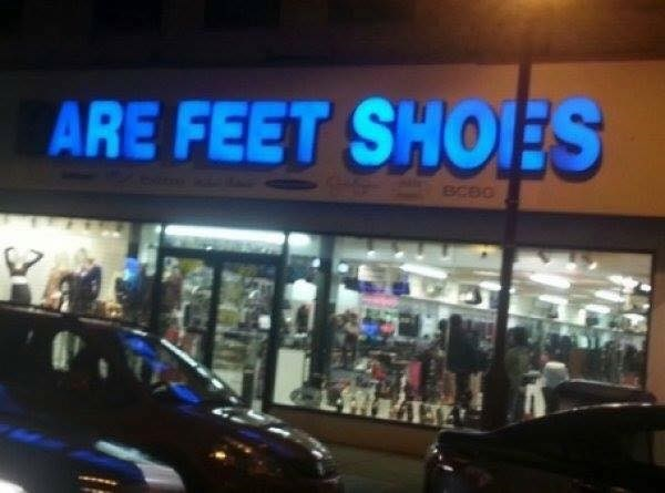 Neon sign with some of the letters out that reads ARE FEET SHOES