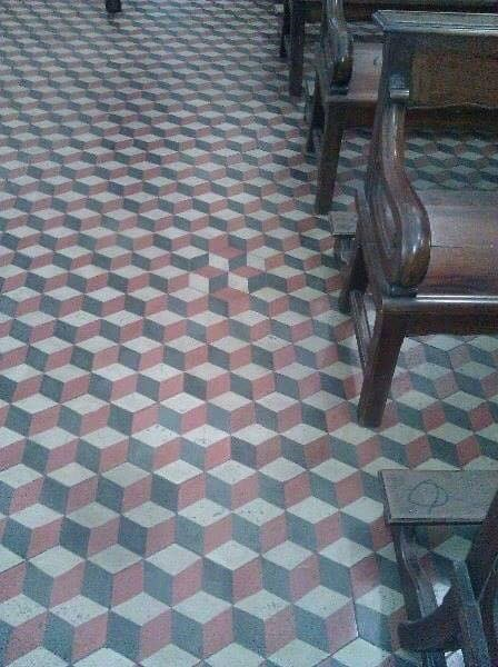 Trippy floor tile with a non-obvious disturbance in the pattern.