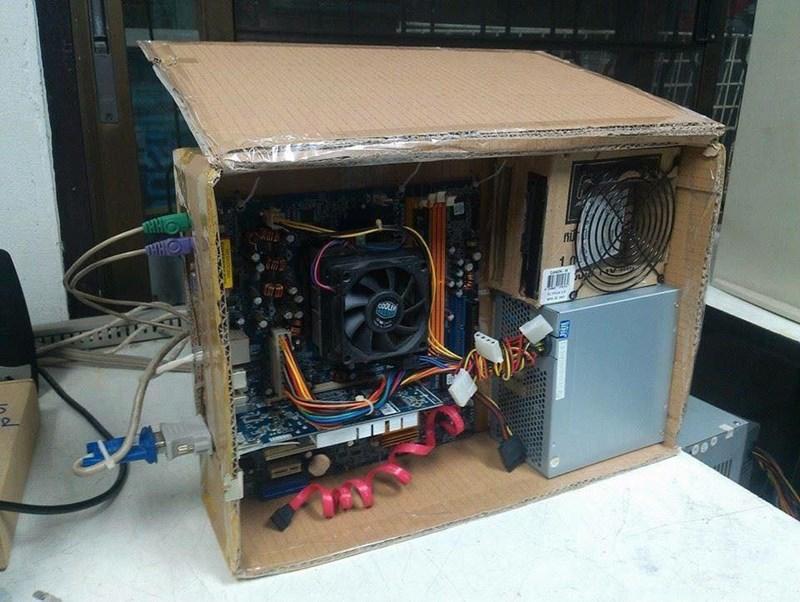 computer in a cardboard box.