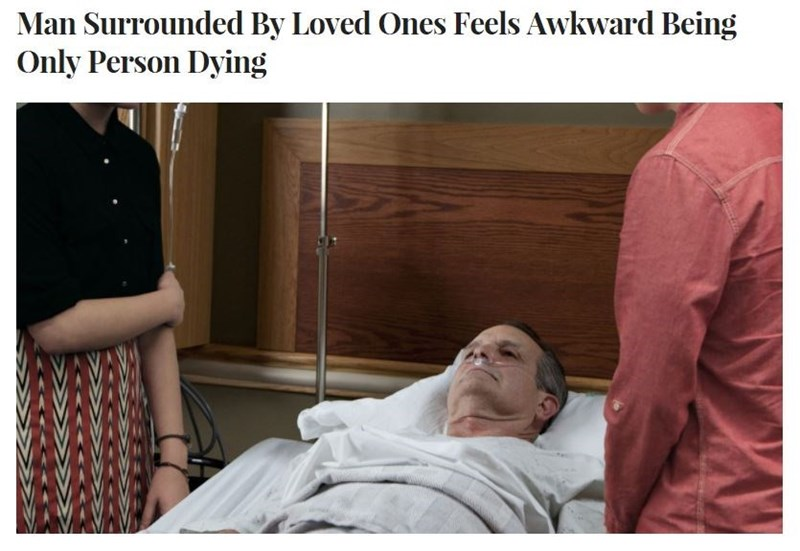 Funny news headline about a man who is dying surrounded by loved ones and feels awkward being the only one dying.