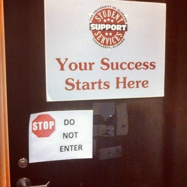 door with sign that your success starts here and a DO NOT ENTER sign right next to it.