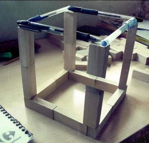 Impossible cube sculpture.