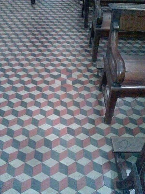 Floor or a church that has a slight error in the pattern.