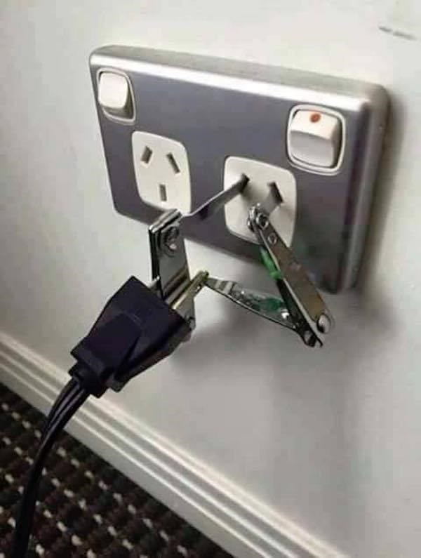 Universal plug adapter made out of nail clippers