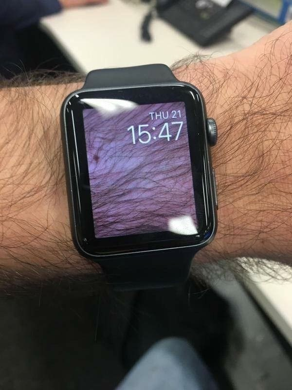 Wristwatch smartwatch that has a screen shot of his wrist on it.