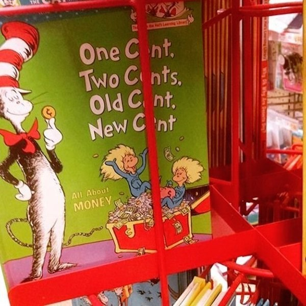 Dr. Suess book with a metal bar blocking some very important letters.