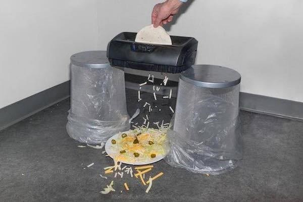 cutting up cheese using the office shredder.