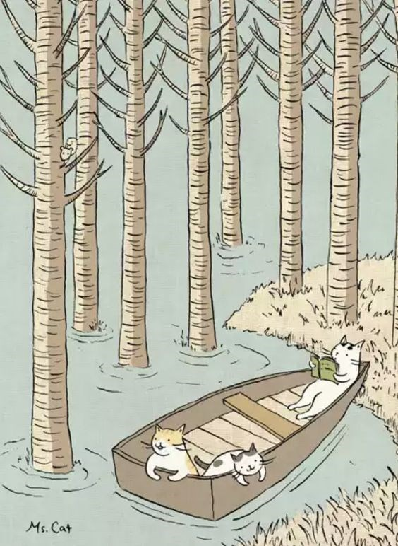 Cats relaxing on a little row boat
