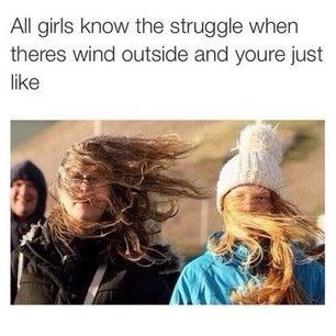 Girl struggle of going outside when the wind puts it in your face.