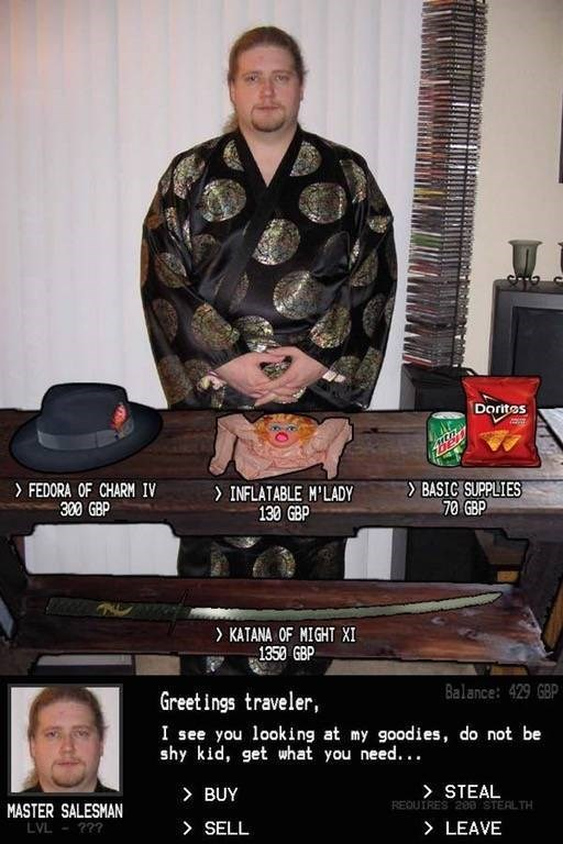 Cringe goatee dude wearing Japanese kimono and offering for sale fedora, inflatable m'lady and Mountain Dew and Doritos
