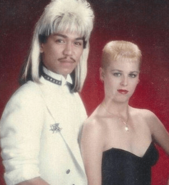 Woman with short hair and man with blonde mullet