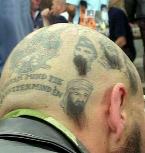 Haircut of tattoos on the man's head with little bits of hair for their beards