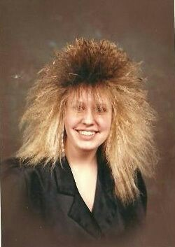 Woman with 80's big hair that is blocking her eyes