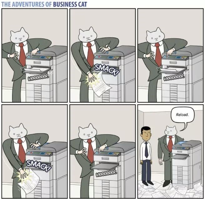 The Adventures of Business Cat Cartoon - fighting with the copy machine.