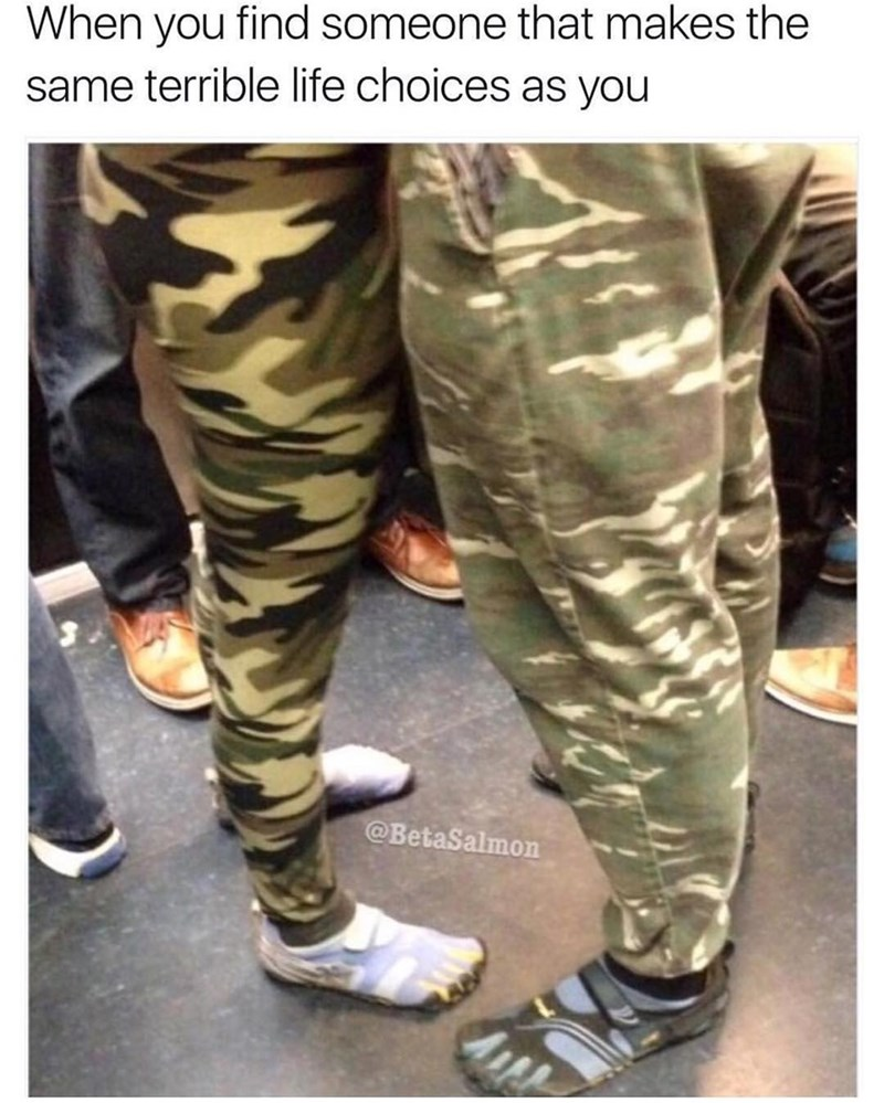 Couple wearing bad choice of camouflage and toe shoes, but at least they have each other.