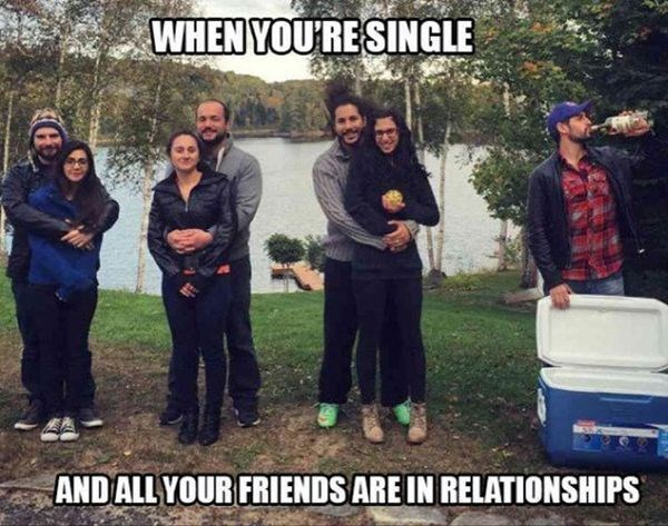 meme about being the only single one with pic of several couples and one man drinking from a cooler