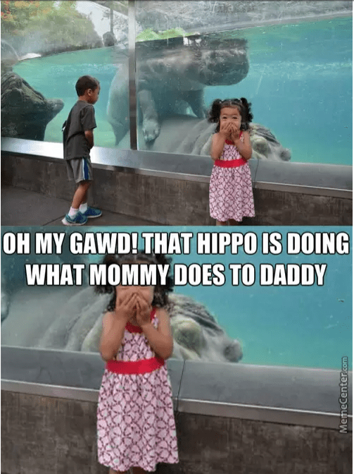 hippos doing it in the tank and little girl laughing at it as boy looks on very curiously.