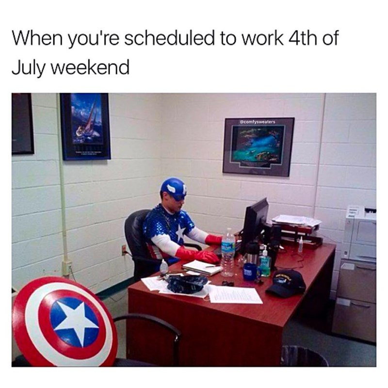 Funny meme about having to work the weekend of 4th of July weekend, man in captain america costume at a desk with a computer.